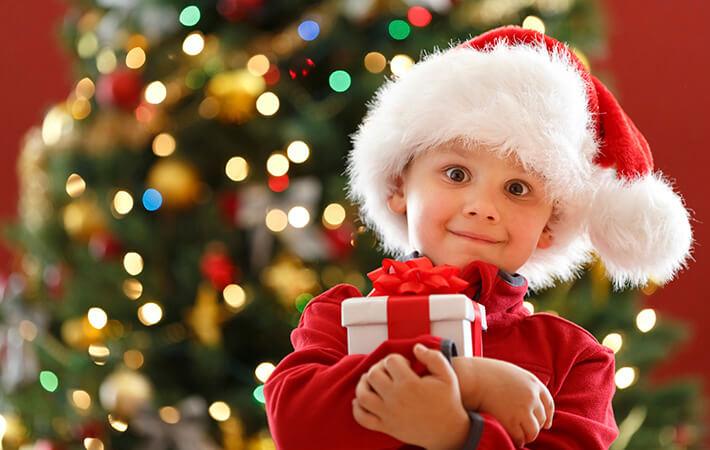 mi christmas present little boy children kids istock - Kids Christmas